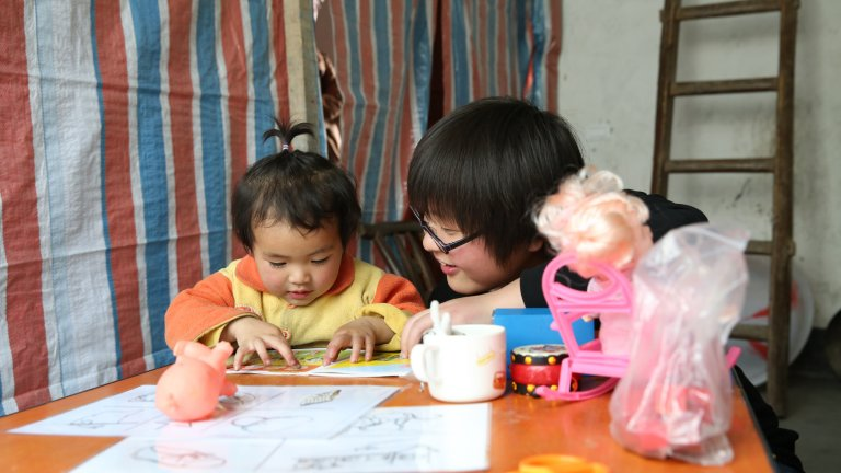 baby reading with trainer