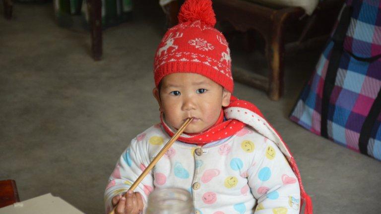 baby with chopsticks