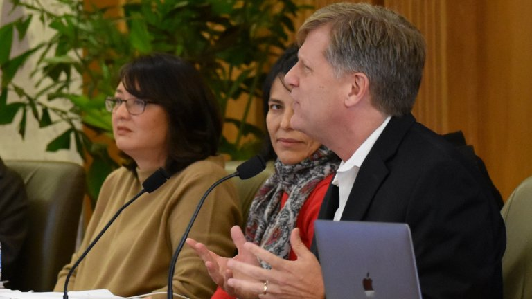 Scholars during a panel discussion