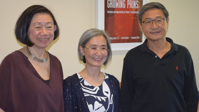 A Global Affiliate Visiting Fellow posing for the camera with APARC faculty Jean Oi and Xueguang Zhou.