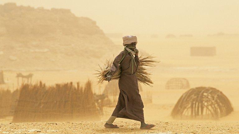 A man walks through a sandstorm in Chad