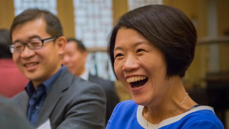 Global Affiliate alumni smiling, in conversation during an alumni reception.