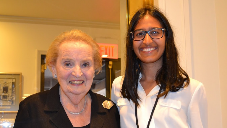 Stanford student and Global Policy Intern Kendra Mysore standing next to former U.S. Secretary of State Madeleine Albright.