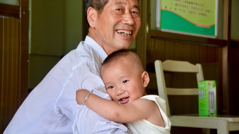 grandad and baby hug