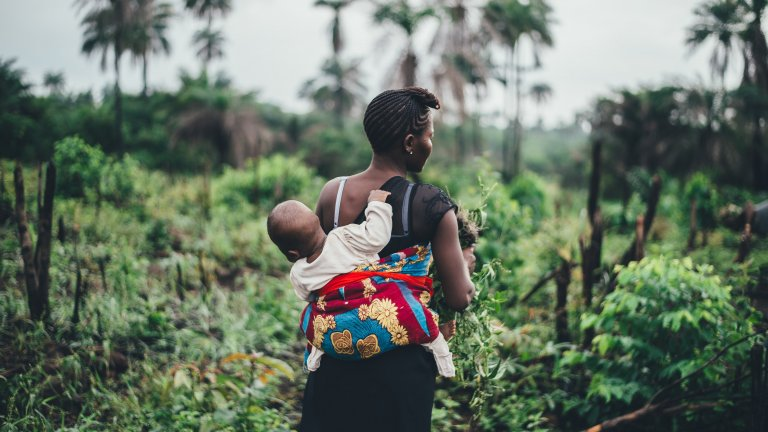 A mother and child in the fields in Sierra Leone.