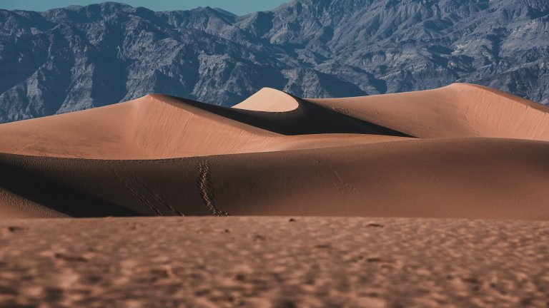 The view of sand dunes in Mesquite Flats, Death Valley National Park.