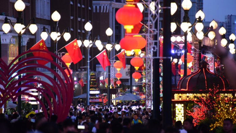 Chinese flag and lanterns on a street in China.
