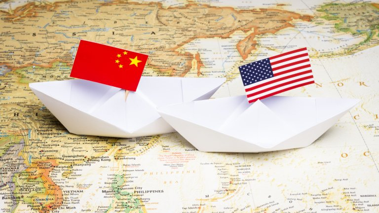 Paper boats with Chinese and American flags