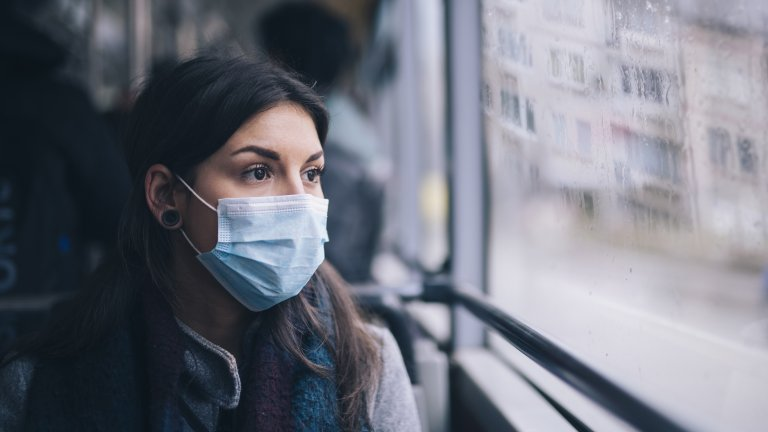 Worried woman in face mask.