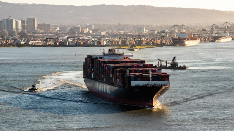 A loaded shipping liner sails out of port.