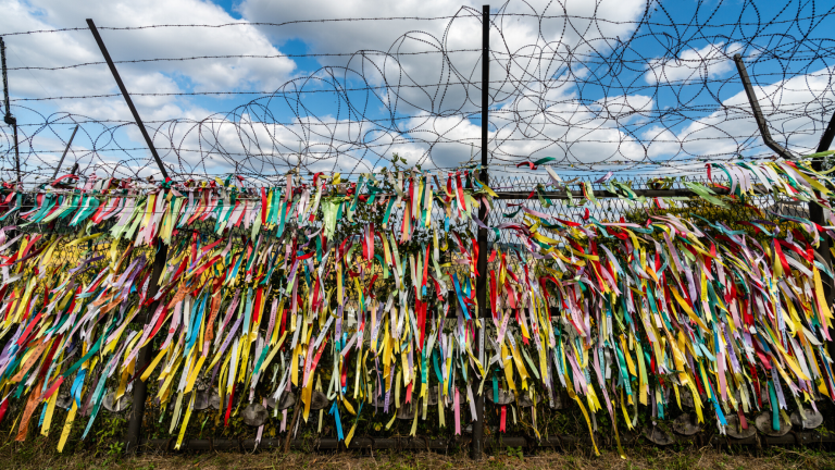 Brightly colored ribbons tied to fences around Imjingak Village in the DMZ on the North Korean Border.