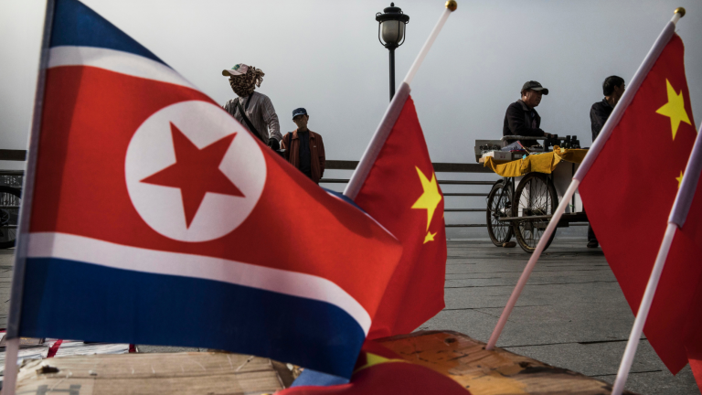 Small flags of North Korea and China for sale near the China-North Korea border