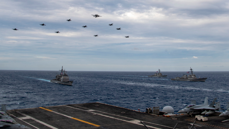 Aircraft assigned to the Theodore Roosevelt Carrier Strike Group fly over the South China Sea
