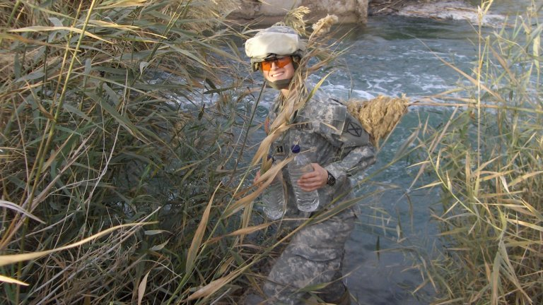 Stanford's Jessica Grembi collects water samples in Iraq.