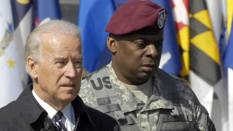 Joe Biden and Lt. Gen. Lloyd J. Austin III attend a ceremony welcoming troops home at Fort Bragg in North Carolina on April 8, 2009.