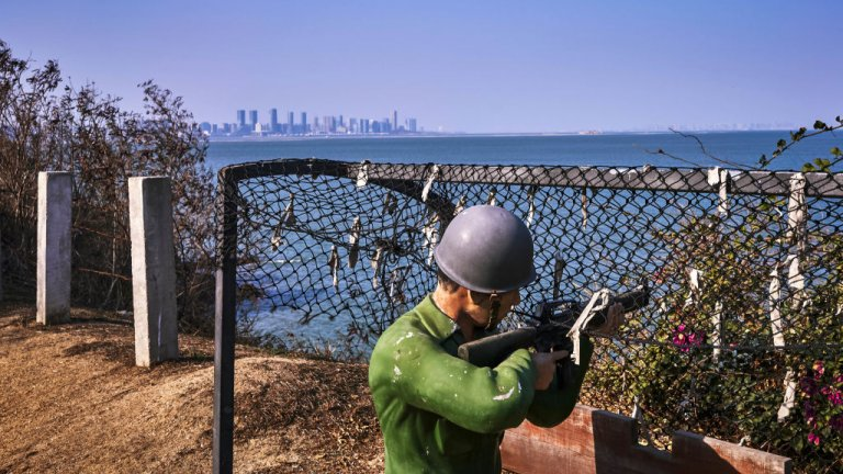 Figures of Kuomintang soldiers are seen in the foreground, with the Chinese city of Xiamen in the background, on February 04, 2021 in Lieyu, an outlying island of Kinmen that is the closest point between Taiwan and China.