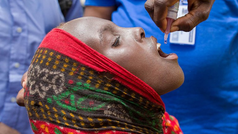 A child receives a polio vaccine in Africa.