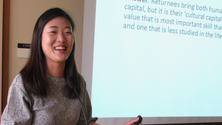 APARC visiting scholar Jane Yeonjae Lee delivering a seminar presentation, standing at a lectern.