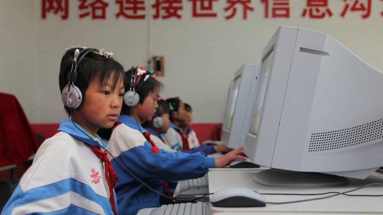 kids with computers headphones