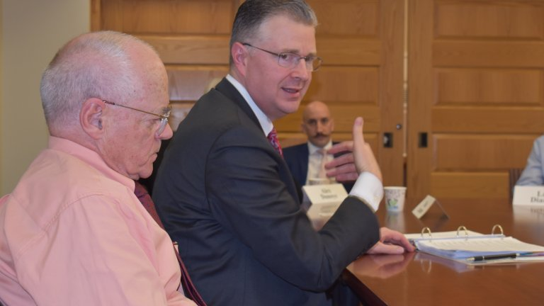 Ambassador Dan Kritenbrink and Donald Emmerson seated at a conference room during a group discussion