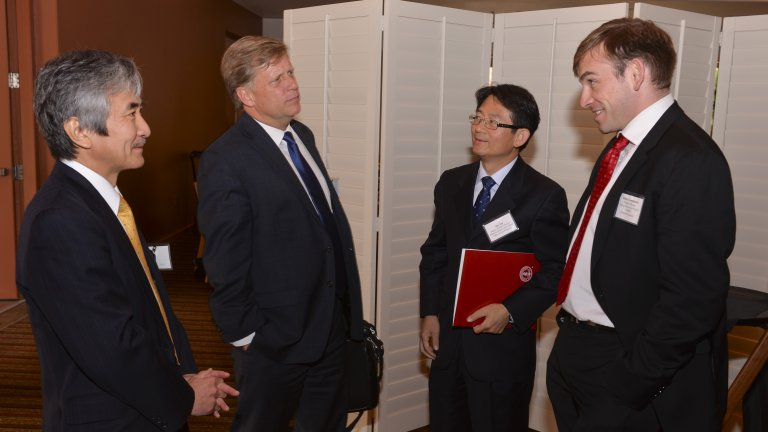 FSI's Michael McFaul and APARC's Khakis Templeman in conversation with two attendees at a reception for Pacific Rim Consuls General and Country Representatives, October 2016.
