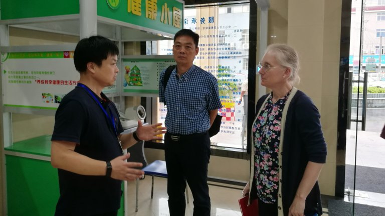 Asia Health Policy Program Director Karen Eggleston speaking with two researchers at the Zhejiang Provincial Center for Disease Control and Prevention, China.
