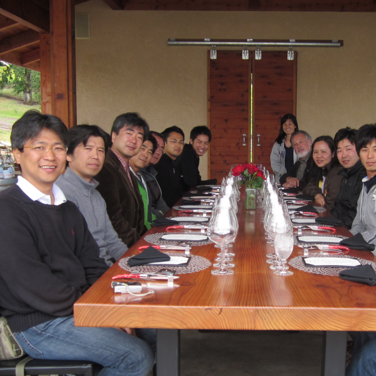 2010-11 cohort of Global Affiliate visiting fellows seated around a table at a Bay Area winery.