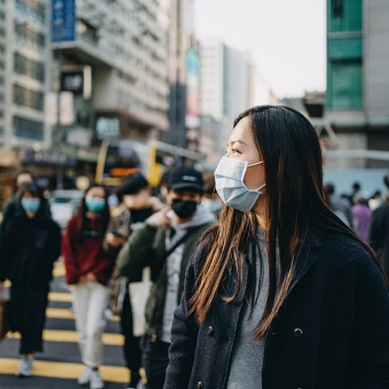 an image of an asian woman wearing a mask on the street