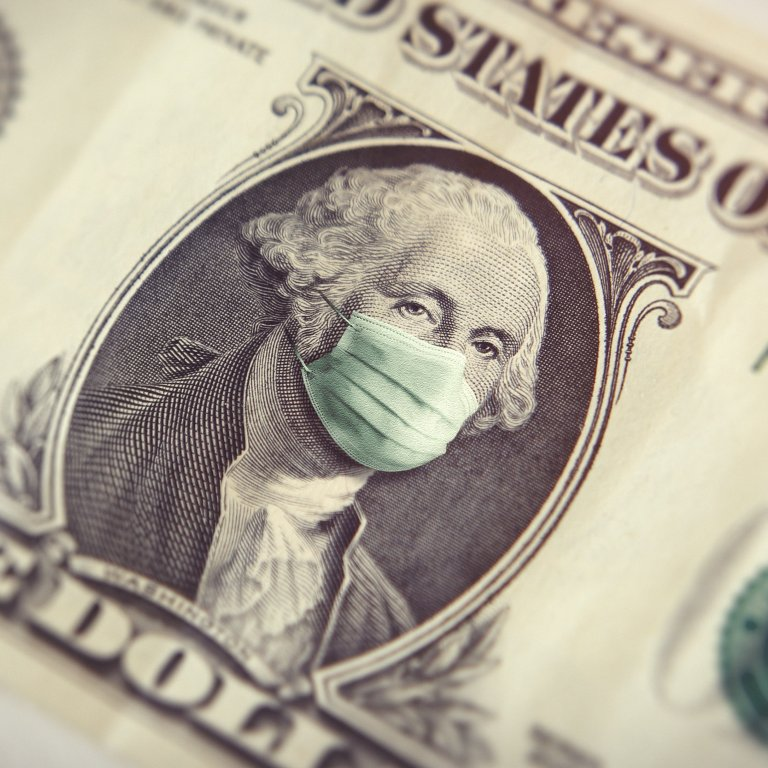 A dollar bill and mask represents the economy during COVID-19 pandemic.