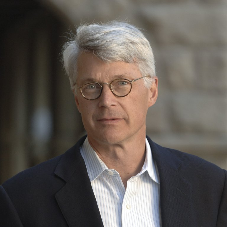 Man with glasses and gray hair