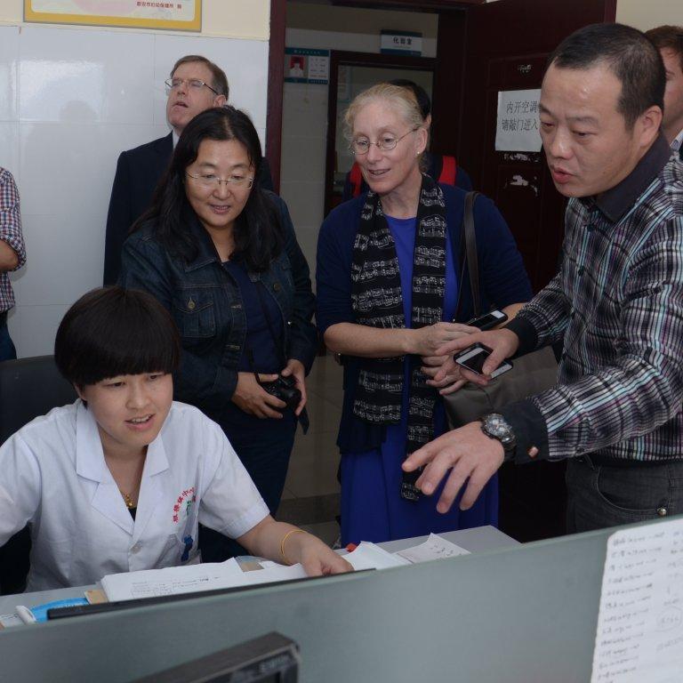 Karen Eggleston visiting a health clinic in China