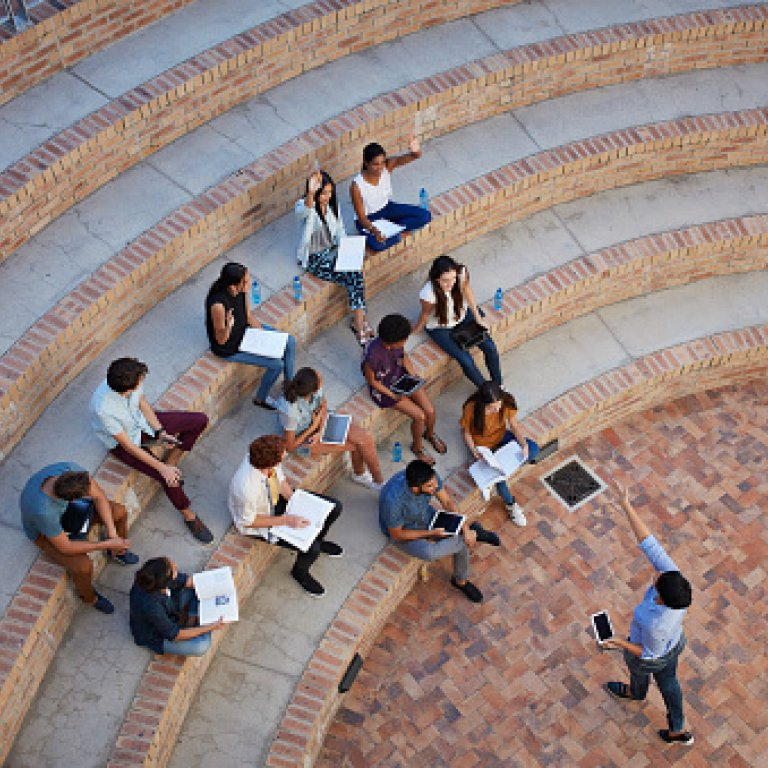 an image of students outside on steps