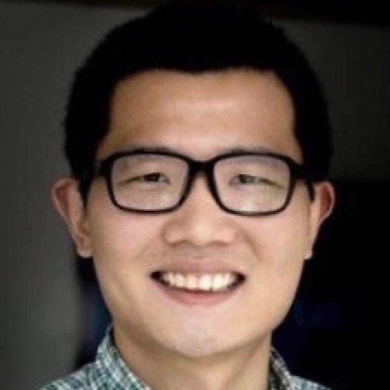 Headshot of Dr. Yiqing Xu.