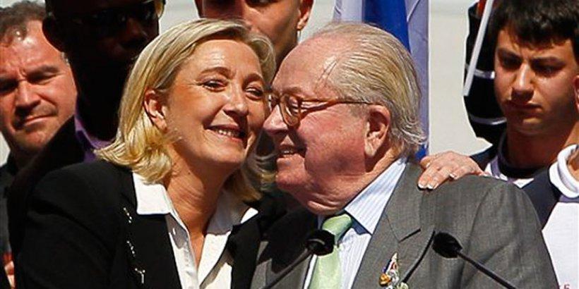 National Front politician Marine Le Pen hugs her father, Jean Marie le Pen