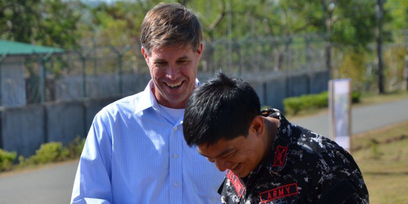 Joe Felter Col  Dennis Eclarin of the Philippine Army Scout Rangers share a laugh after a ceremony honoring Felter's work in the Philippines
