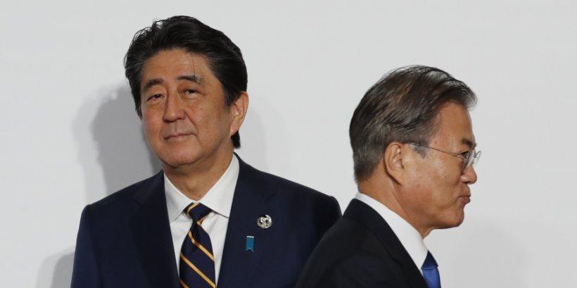 Japan Prime Minister Shinzo Abe and South Korea President Moon Jae-In