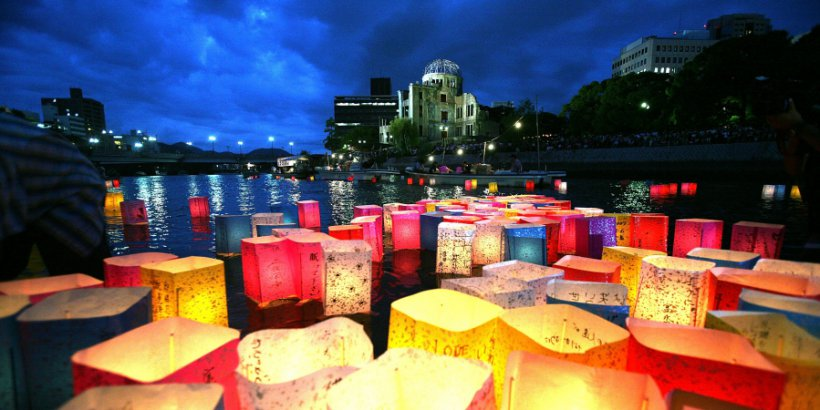 Candles and paper lanterns float on the Motoyasu River in front of the Atomic Bomb Dome at the Peace Memorial Park, in memory of the victims of the bomb on the 62nd anniversary of the Hiroshima bomb, on August 6, 2007 in Hiroshima. Japan.
