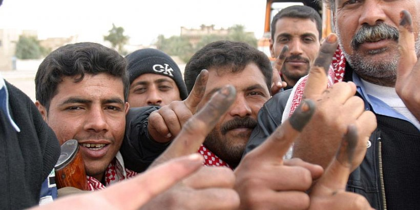 iraqi voters inked fingers