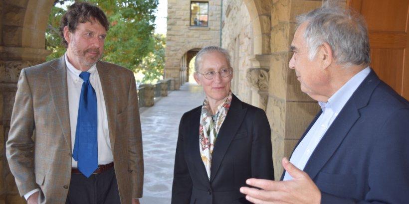 John Donahue, Karen Eggleston, and Richard Zekhauser converse outside Encina Hall