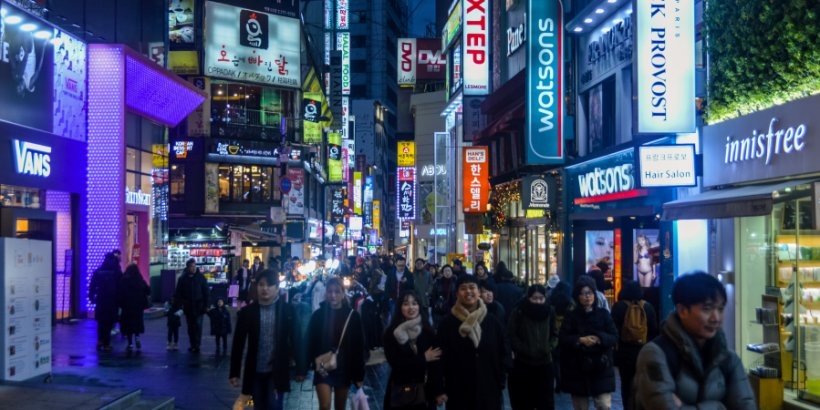 People walking at night in Myeongdong district of Seoul, South Korea