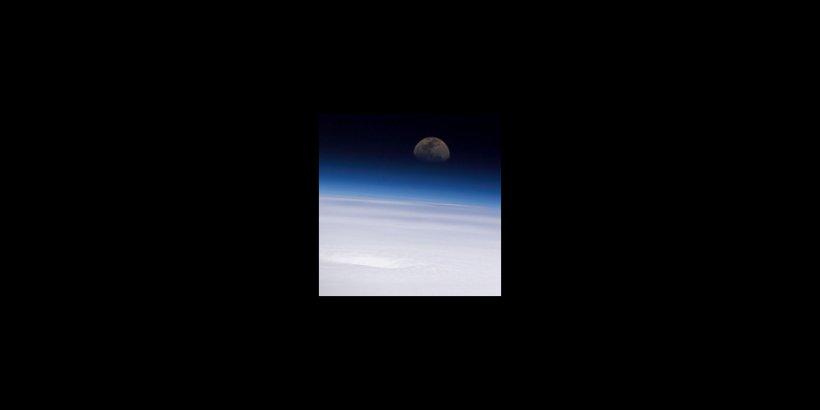 Hurricane Emily and moon
