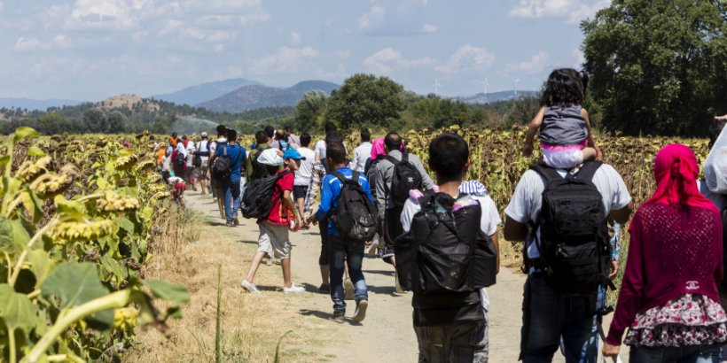Shutterstock photo of immigrants at the border between Greece and Macedonia.