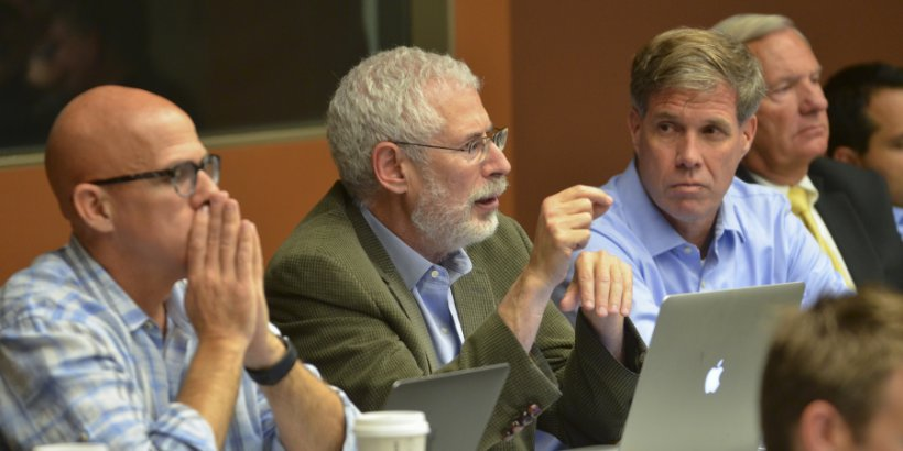 Influential startup educator Steve Blank (center) gives advice to Stanford students working on tough national security problems, while retired U.S. Army Colonels and class co-teachers Joe Felter (right) and Pete Newell (left) listen in.