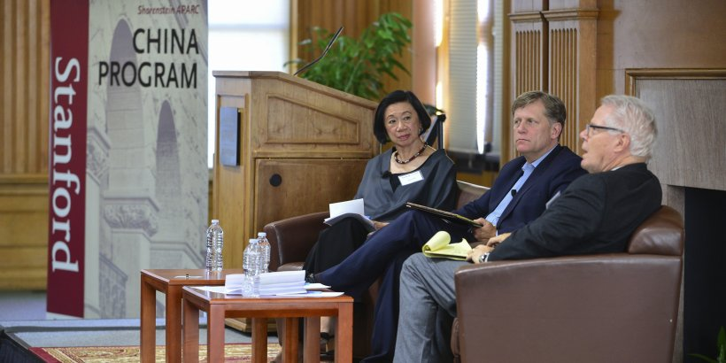 Jean Oi and Mike McFaul listening to David Lampton speak at Oksenberg Conference