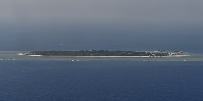 View from a C-130 transport plane towards Taiping island during a visit by journalists to the island in the Spratlys chain in the South China Sea on March 23, 2016.
