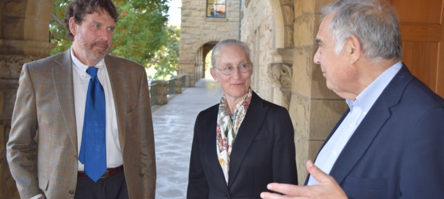 John Donahue, Karen Eggleston, and Richard Zekhauser converse outside Encina Hall