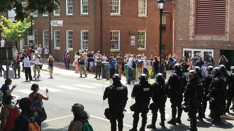 "Police officers and protesters at the ""Unite the Right"" rally in Charlottesville, Virginia in August 2017"