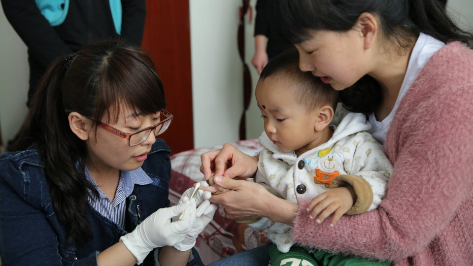 doctor baby blood sample