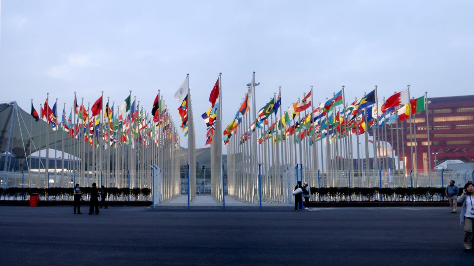 World flags, with China's at the front, at the south entrance of Expo 2010 Shanghai, near the Expo Boulevard, in front the China pavilion.
