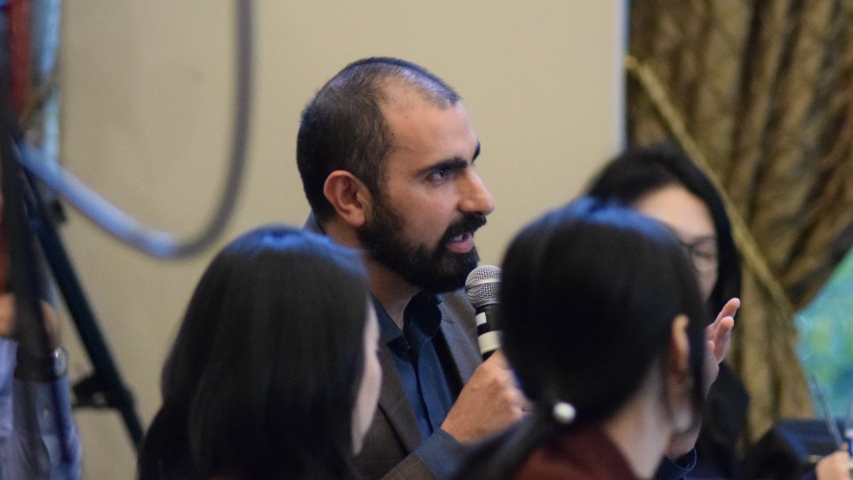 2018-19 Koret Fellow Andray Abrahamian presenting a question from the audience during a Korea Program conference